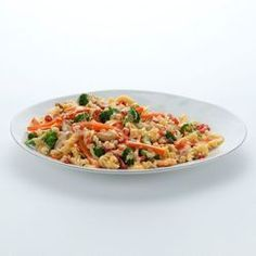 Easy chicken skillet recipe cooks chicken, pasta and vegetables in one skillet, finished with zesty tomatoes and Velveeta. Velveeta® is a registered trademark of Kraft Foods, Inc. Ro*Tel® is a registered trademark of ConAgra Foods RDM, Inc.