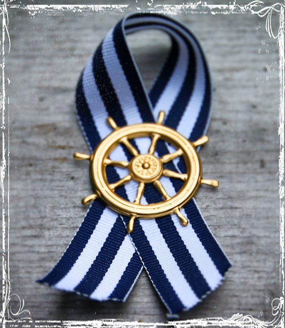 Nautical boutonniere - might be a bit simple but could be paired with a pretty white (or even red) flower--- This is tied in the same fashion as those ribbons that are in remembrance of military personel