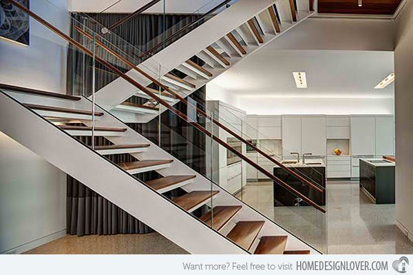 A free standing staircase with glass balustrade and floating steps, it is elegant with sleek white and wood finish stairs.