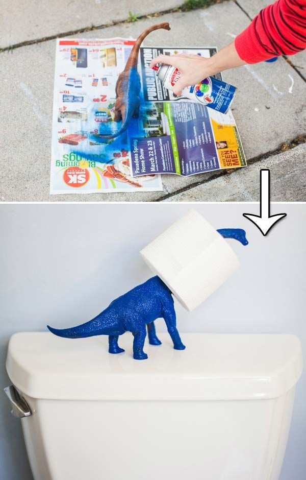 #10. Spray paint a toy dino to make a holder for toilet paper.