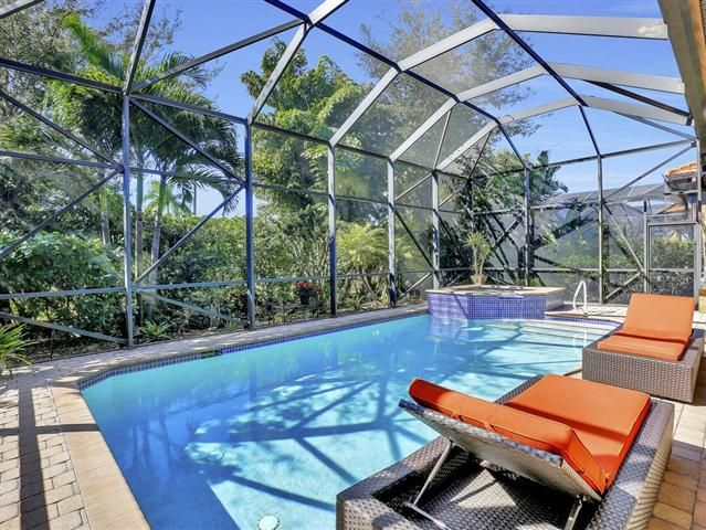 Beautiful south facing home features over 100000 in options and upgrades.  Enjoy the tropical garden setting with natural private preserve views from your large screen enclosed lanai.  This 2 bedroom plus den 2 bath and 2 car garage is the popular San Remo II open floorplan.  This home features a salt water pool and spa with a remote valves for spa gourmet kitchen with granite counters tile on the diagonal cherry wood cabinets air conditioned garage with storage cabinets a work bench with…