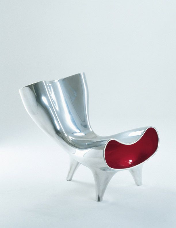 Marc Newsons Orgone Chair. Got a plastic one in my office. More of a sculpture than a useful chair though, as it tips easily. But really easy on the eyes!