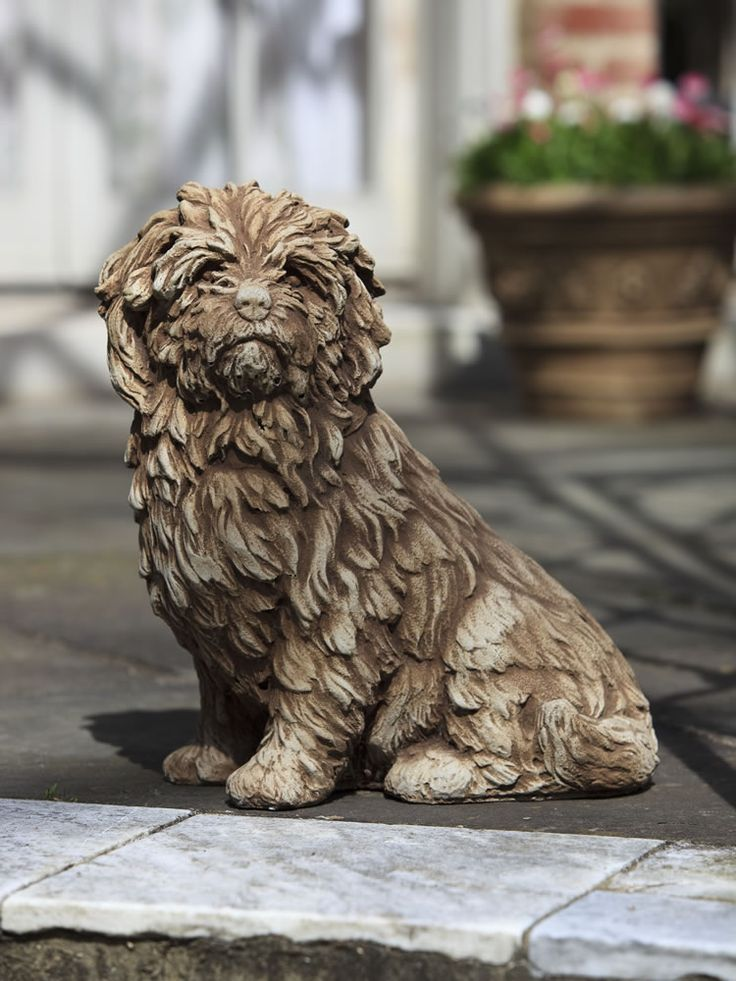 "This fluffy pup is sitting quietly, a hopefully expression on his face. Is it time for my walk? Cute concrete dog statue is 15"" tall and comes in a variety of finishes. Visit our site for more details."