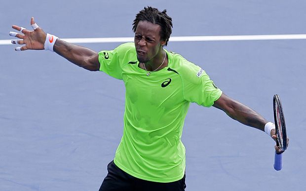 Bulgarian seventh seed loses in straight sets as Frenchman reaches last eight at US Open for the second time.