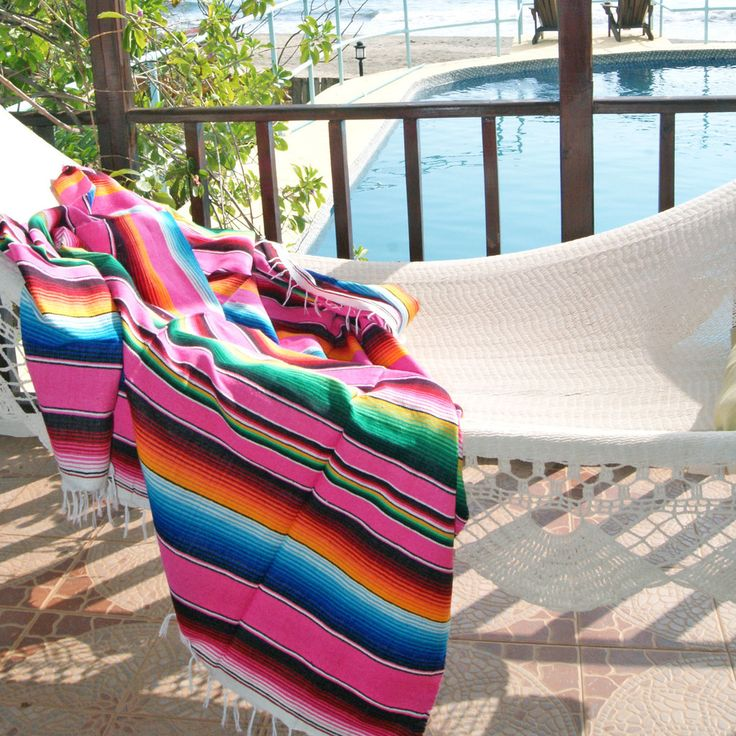 Bright colored Mexican blanket We. Love. These. Blankets. Seriously, cannot get enough. I want to recover my dining chairs, car seats, my dog's leash, duvet cover, you name it. There is just something