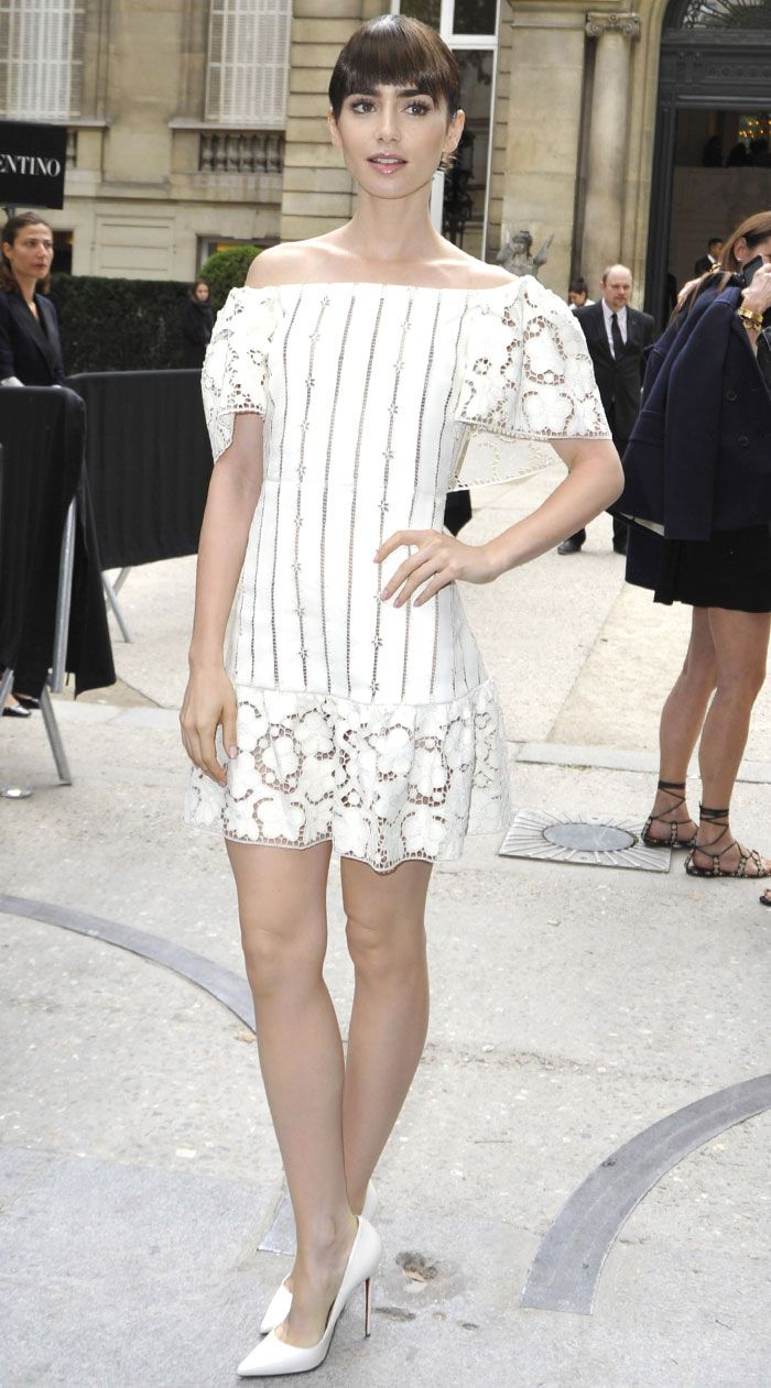 Lily Collins parades legs in white bardot dress