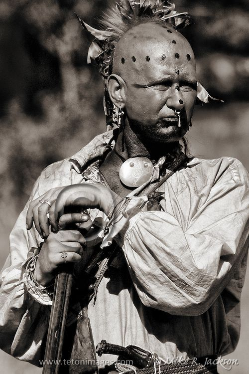 Shawnee Native American in traditional costume and weapons.