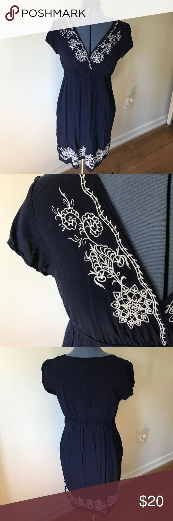 Charming Charlie embroidered dress Soft and airy, this whimsical embroidered dress is perfect for warm summer days. Classic navy blue with elegant white embroidery. Excellent condition. Charming Charlie Dresses