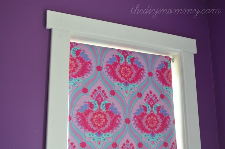 DIY No-Sew Fabric Covered Blackout Roller Blinds by The DIY Mommy. Just use spray adhesive, fabric and ribbon for an exciting update to your...