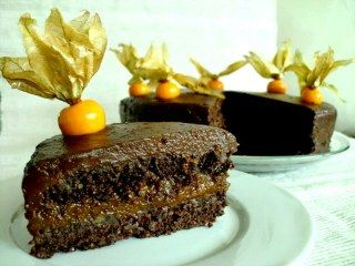 Raw Sacher Torte - Mozart's music and the Sacher Torte! My raw version follows the same guidelines as the original with two thick layers of chocolate cake, an apricot jam center and smothered in rich chocolate frosting! It is wonderfully rich and chocolatey without being too sweet and looks gorgeous topped with Cape Gooseberries.
