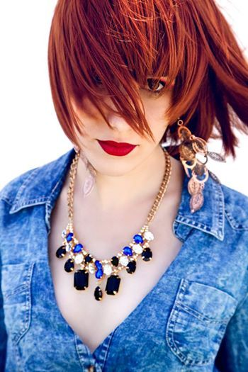 Red hair girl. Long earings and necklace. Red lips. Russia. Rusia. Argentine. Argentina. Chica pelirroja, con aros largos y collar de piedras.  Fashion