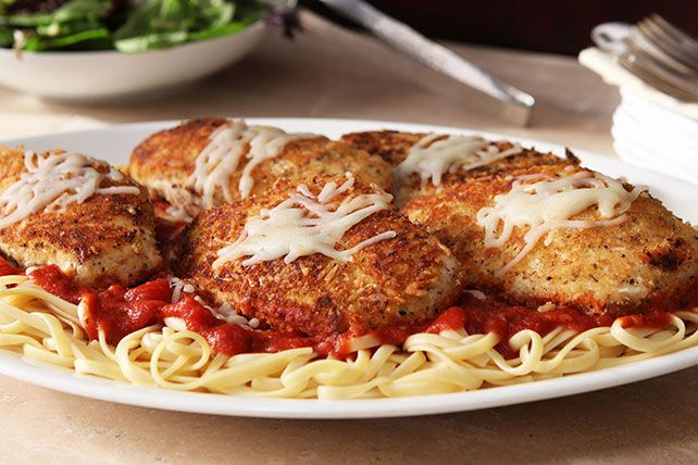 Chicken breasts get a crispy coating of Parmesan and bread crumbs and pair with zesty marinara in this homey version of an Italian pasta classic.