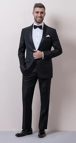 CLASSIC BLACK TIE It's a tradition for a reason. The black tuxedo ensemble is the most formal suit there is. European made shawl collar tuxedo in Super 120s Luxury wool from the world famous Guabello fabric mills of Italy. Tailored slim fit sillouette in classic tuxedo stling