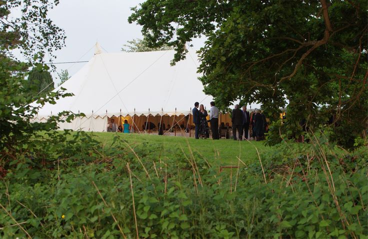 40' x 80' Traditional Canvas Pole Tent with open sides.