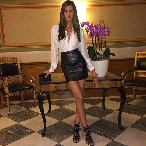 Izabel Goulart rocking elegant white blouse and leather mini skirt ...