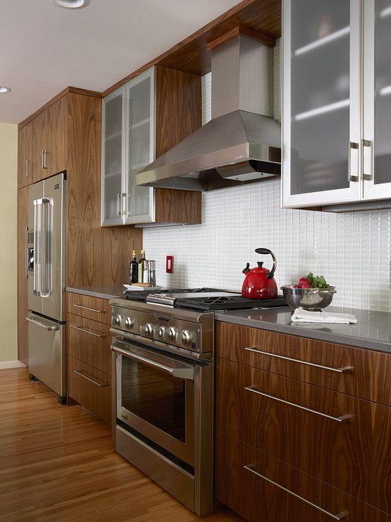 Walnut Cabinets White Tile Backsplash Stainless Steel Appliances Wood Flooring