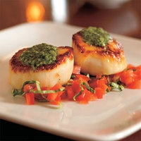 Slightly fancy weeknight dinner? Pan-Seared Scallops with Pesto and Tomato via @rachaelraymag