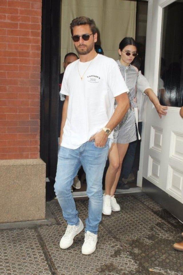 Scott Disick wearing Captain Fin Sanitation Service Tee, Adidas Adidas Yeezy Calabasas Powerphase, Saint Laurent Slim-Fit Distressed Washed-Denim Jeans