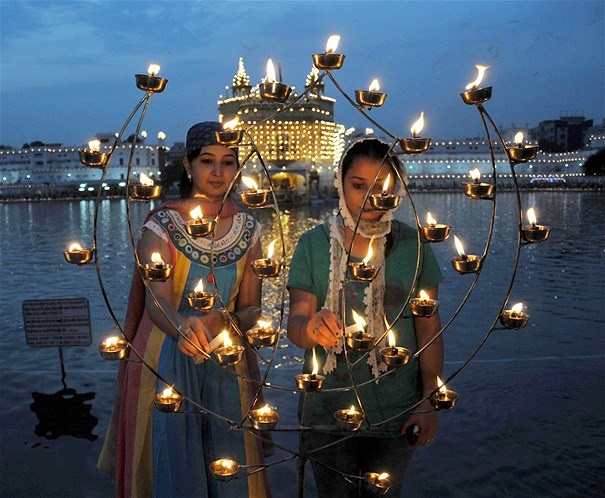 Image: Devotees light candles at the Golden Temple during the Baisakhi festival, which celebrates Sikh New Year & the founding of the Sikh community, in Amritsar, India, on April 14 (© Xinhua/Zuma Press)