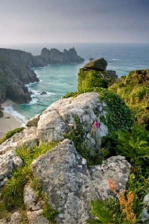 Porthcurno Beach on the Lands End Way Cornwall, UK. The Cornish Coastal Path is 330 miles long and covers some of the most dramatic and historic scenery in Great Britain.