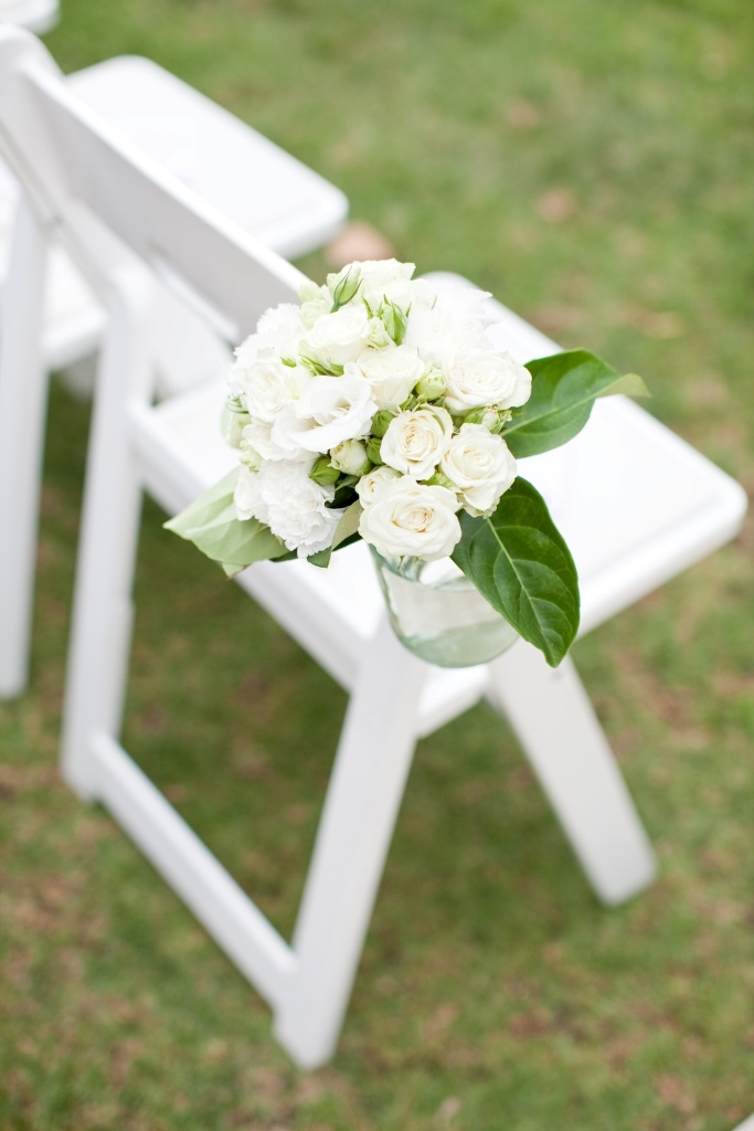 Ceremony chair with a hanging jam jar filled with fresh white flowers www.touchedbyangels.com.au
