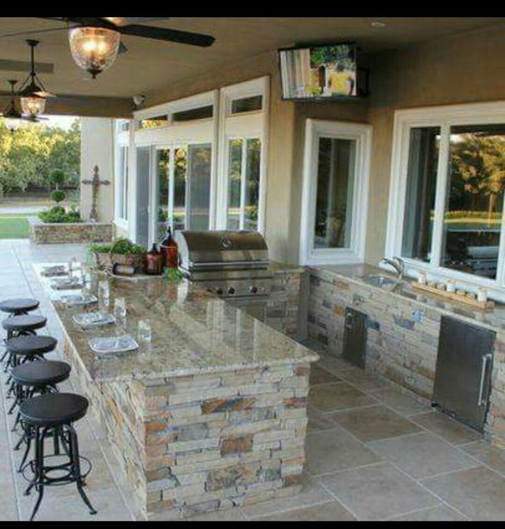 Note to self: Next time you design a house, don't waste space on a formal dining room. Build a nice big breakfast area inside and add this outdoor eating bar instead! You will use it 100 times a year instead of 2.