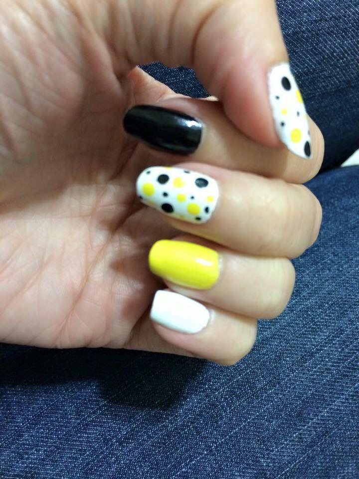 Black and yellow polka dot nails