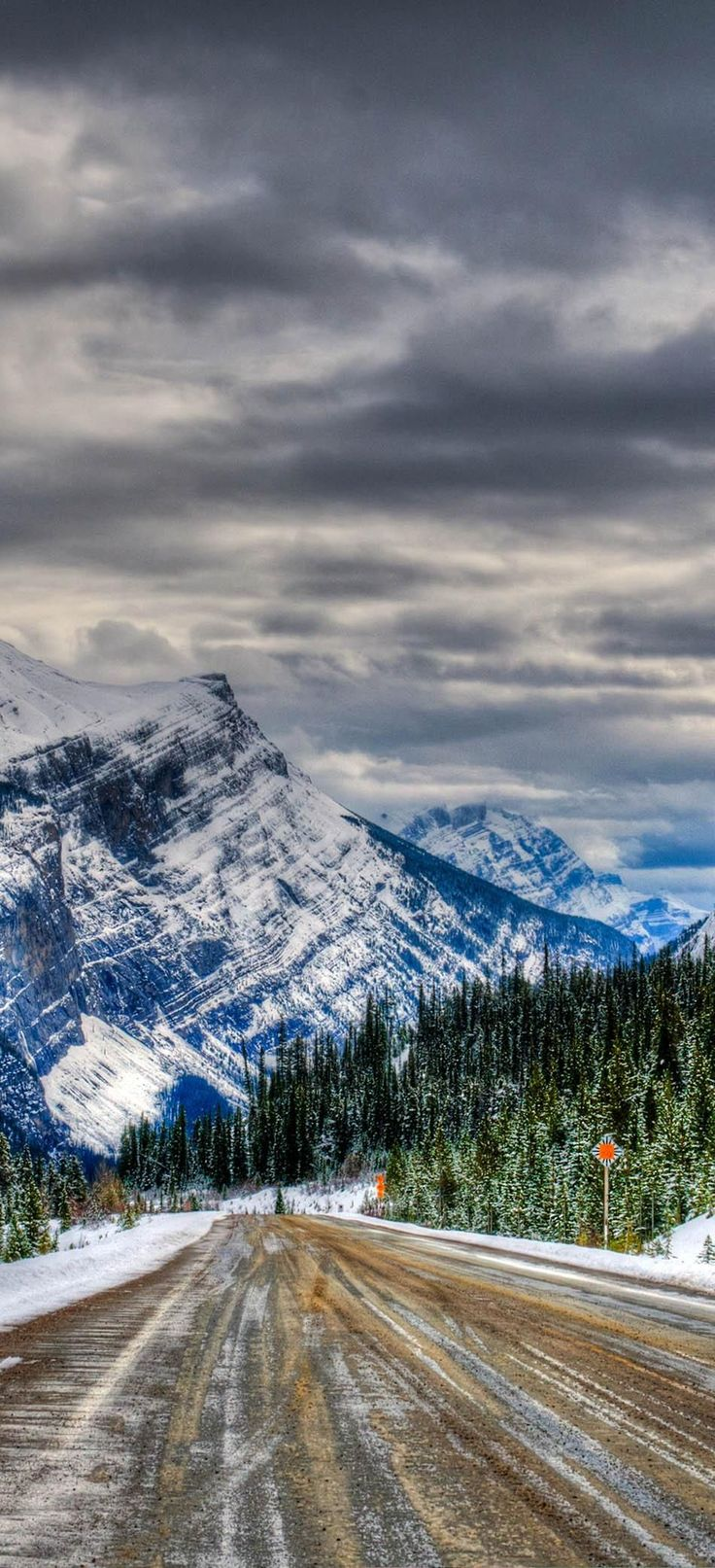 Icy winter road, Icefields Parkway, Banff and Jasper National Parks Alberta Canada   23 Roads you Have to Drive in Your Lifetime