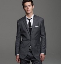 Partial to the cut; perhaps three-piece for the groom, and black for the suit itself... But charcoal grey accents and charcoal grey suits for the groomsmen.