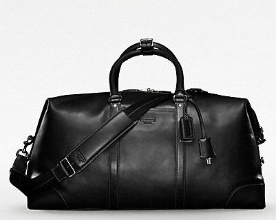 Grown men carry nice luggage. It's just a fact. This Coach Transatlantic Travel Carryon in sleek black leather is a good, functional place to start. $648 via Coach.