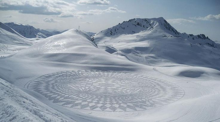 Boldly treading where few other artists have tread before, and armed only with a pair of snow shoes and an Oxford education in Engineering Science, Simon Beck is a self-employed map maker who spends up to 9 hours at a time treading out vast and incredibly intricate crop circle-esque pieces of art in fresh snow. What makes these pieces even more amazing is the precision and scale given that Beck uses only a sighting compass and string or paces for measurement! Stunning.