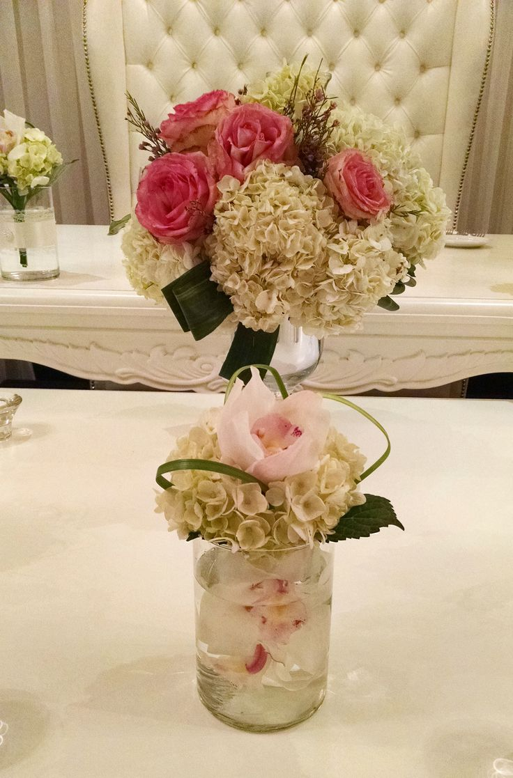 White hydrengea and pink roses on a headtable with white cymbidium (detail)