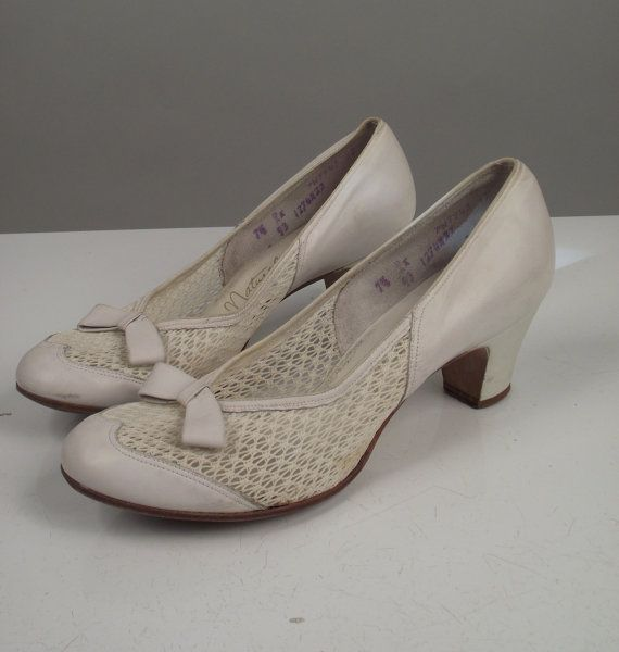 Awh how cute! 40s wedding shoes :)