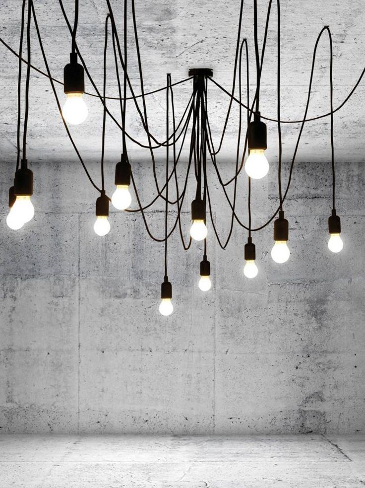 Seletti's Maman is a fantastic, sprawling spider-like Chandelier with tentacle wires emerging from the center.