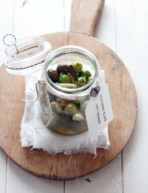 marinated olives with oregano, garlic and preserved lemon. from the edible balcony. photographed by alan benson.