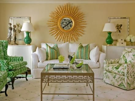 Vibrant green accents and a stunning sunburst mirror shine in this radiant living room by Tobi Fairley.