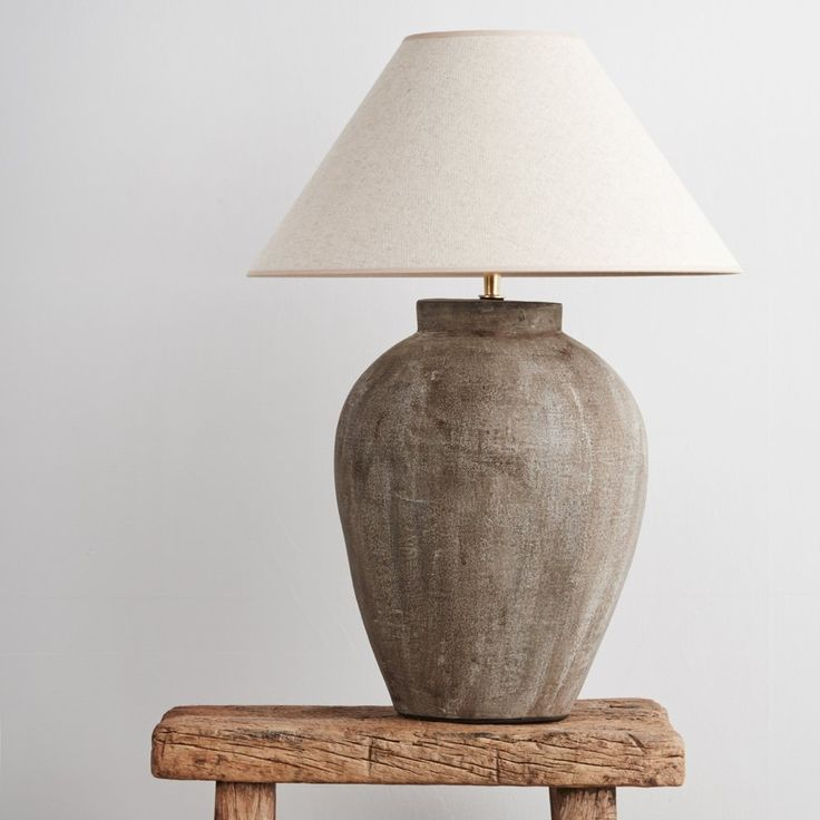 Table lamp with an ovoid ceramic base and natural linen empire-shaped shade. Handmade in Belgium