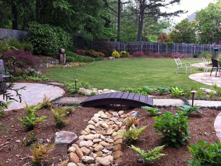 Bridge over dry creek bed garden pinterest dry creek for Fish pond bridges