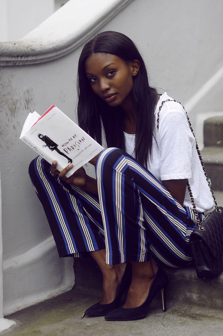 white tee + striped trousers + black heels + black Chanel bag