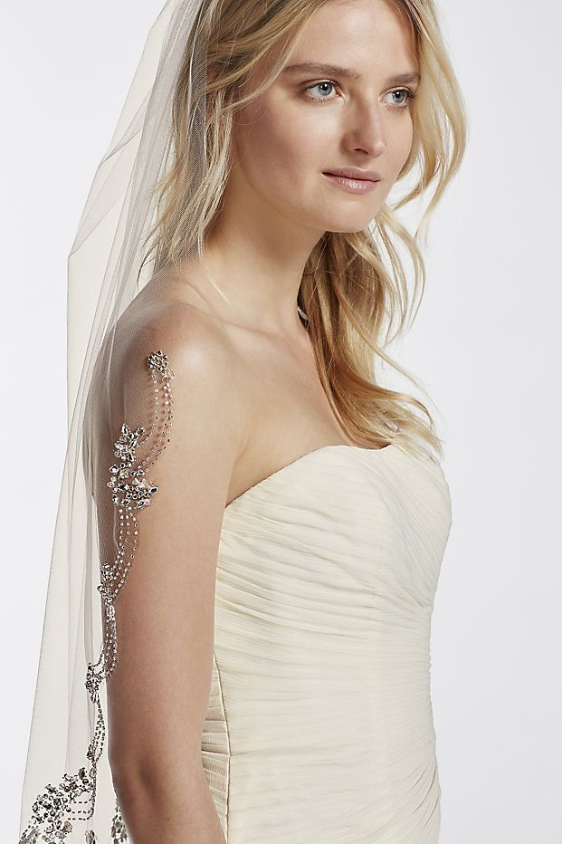 Ultra-chic and on trend, this statement piece veil is the definition of vintage-inspired glam!  Make a fashion statement on your special day in this single tier veil dripping in crystals.  Bottom edge