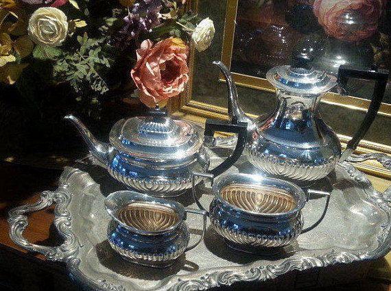 Gorgeous half-rib silver plate tea set. Pretty ebony look finials and handles. So shiny!