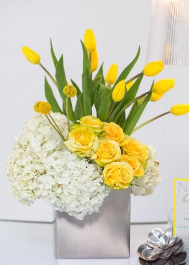 Vibrant yellow centerpiece, hydrangea, roses and tulips Gail's Favourites