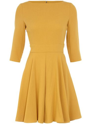 Love the dress, but who decided anyone looks good in mustard yellow and this is the new it color?