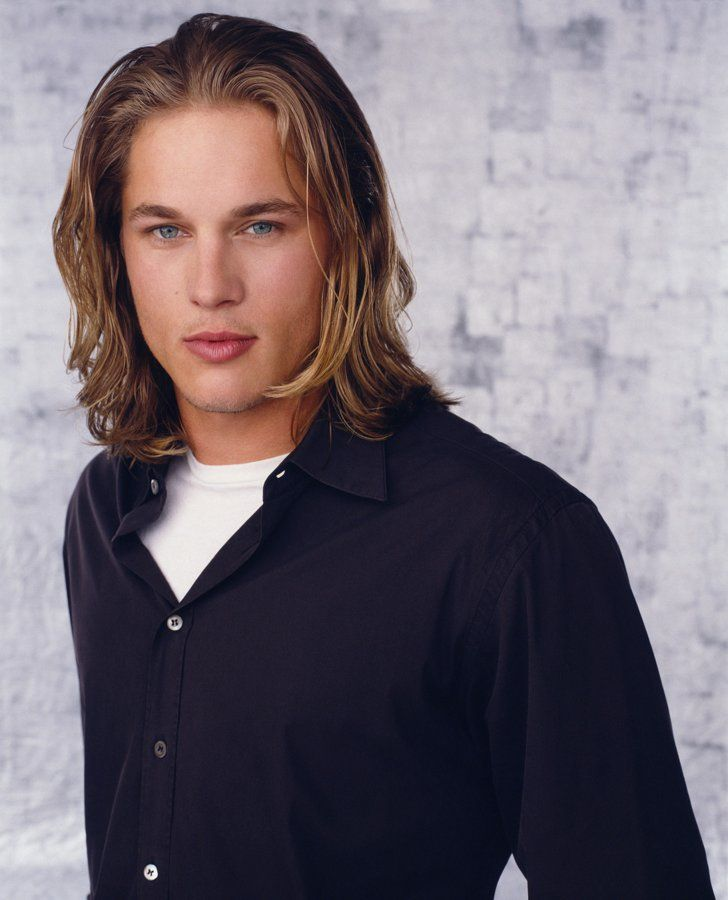 Pin for Later: If You Love Charlie Hunnam and Don't Know About Travis Fimmel, You're Missing Out He also rocked smooth skin for the short-lived show Tarzan.