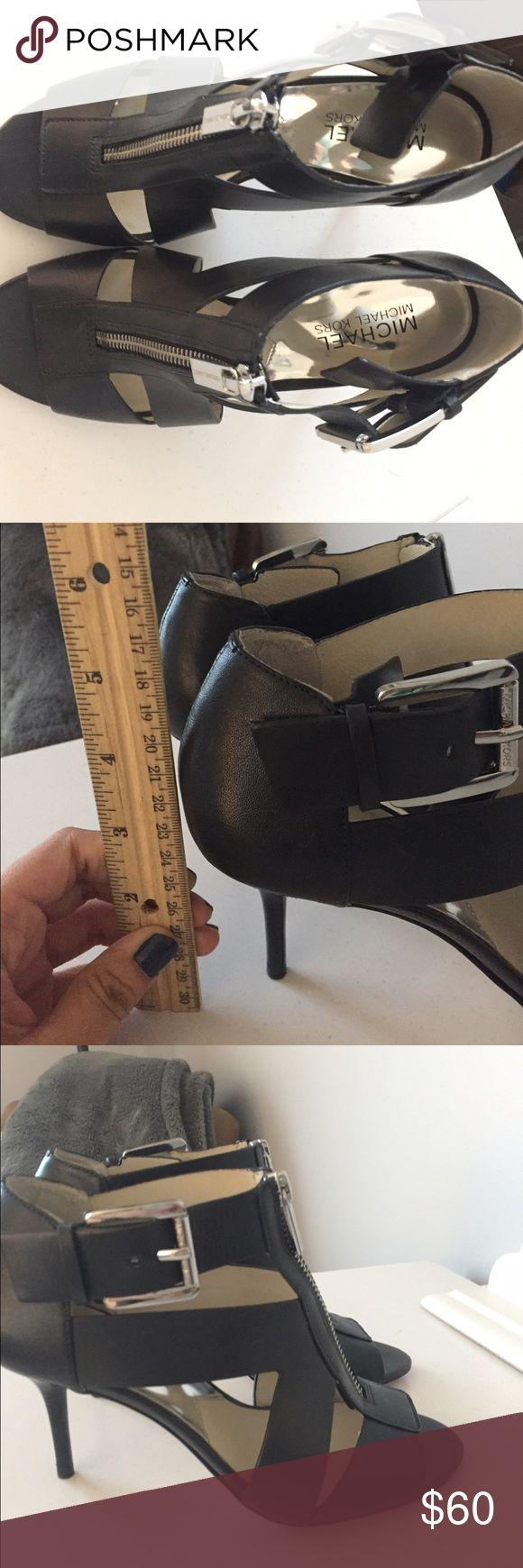Michael Kors black zip up heels Michael Kors Black zip up heels. Worn a couple of times and in good condition. MICHAEL Michael Kors Shoes Heels