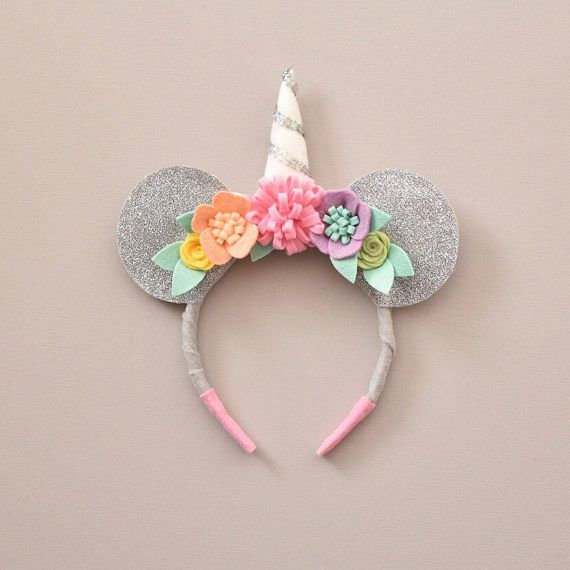 Adorable Minnie Mouse inspired headband handmade with high quality wool blend felt. Ears have silver glitter on the front that does not shed! Silver felt on the back. Headband hand wrapped in felt. Soft and comfortable! Ears are double layered with an inner layer of batting to make thicker and sturdy. Rainbow sherbet hand cut flowers and white/silver sequin unicorn horn. One size fits all headband.