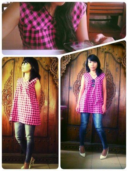 Pink tartan mini-dress combined with blue jeans