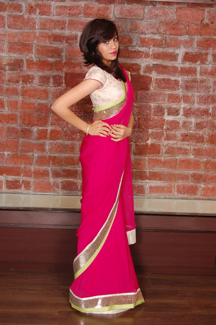 Attractive pink sari with pearl white brocade blouse