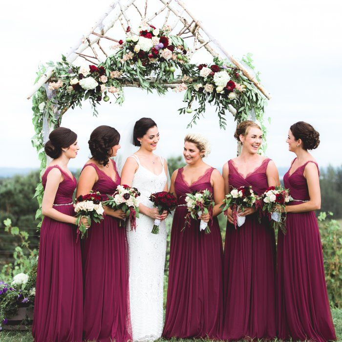 Beautiful bridesmaids! The bridesmaids' wine-colored BHLDN dresses served as the jumping-off point for their color scheme inspiration. Warm creams and vivid greens complemented their bold vision.""