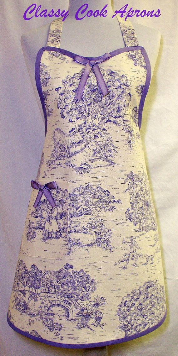 Amazing designer Pastoral Toile screen print in Lavender on Ivory colored medium weight linen-like cotton. This lovely vintage-looking apron may very likely become a family heirloom because the fabric wears like iron. Trimmed in Lavender with Lilac saddle stitched satin bows at center bib and on the perfectly matched and lined right hand pocket.
